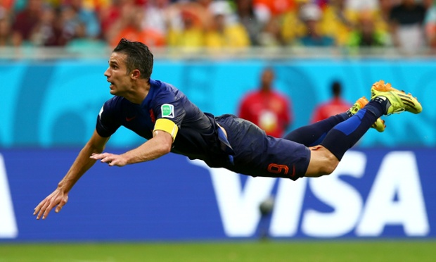 Robin van Persie dives to head home the equaliser for Holland against Spain
