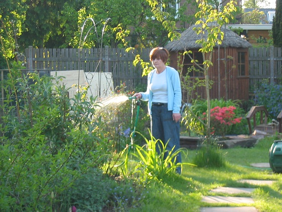 sandra watering the garden